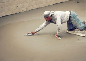 smoothing out the grout in a slab releveling project in Dieppe