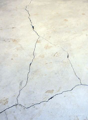 severely cracked, heaving slab floors in a home in Grand-barachois