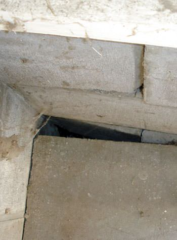 inward rotation of a foundation wall damaged by street creep in a garage in New Waterford