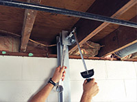 Straightening a foundation wall with the PowerBrace™ i-beam system in a Glace Bay home.