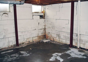 A failed, rusty i-beam foundation wall system installed in Antigonish.