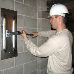 installing a wall anchor to repair an bowing foundation wall in Glace Bay