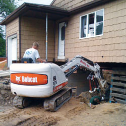 Excavating to expose the foundation walls and footings for a replacement job in Riverview