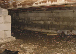 Rotting, decaying crawl space wood damaged over time in Grand-barachois