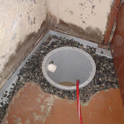 Installing a sump in a sump pump liner in a Fredericton home