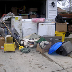 Soaked, wet personal items sitting in a driveway, including a washer and dryer in Dieppe.