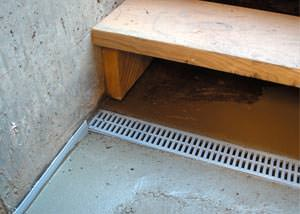 a hatchway entrance in Miramichi that has been protected from flooding by our TrenchDrain basement drainage system.