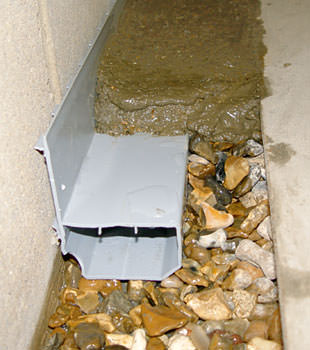 A basement drain system installed in a Dieppe home