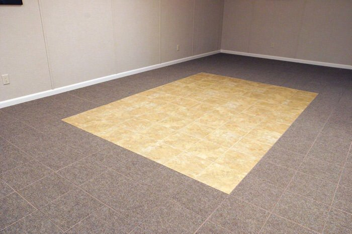 tiled and carpeted basement flooring installed in a Dartmouth home